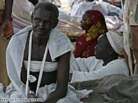 An man injured in clashes with tribal fighters outside the African Union Mission in southern Darfur in 2007.