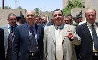 Hussein al-Tahan, governor of Baghdad province, walks with Sheik Sa'ed Jasim, the head sheik in Tarmiyah, to the first Joint Rural Planning Committee meeting in Tarmiyah June 13.
