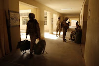 U.S. Marines move out of Joint Security Station Khadairy in the northern District of Fallujah June 18. The movement means the building is now solely an Iraqi police station.