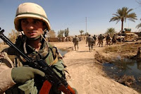 A soldier from the 13th Georgian Army Battalion provides security during a joint clearing operation with Iraqi troops in Ali Shaheen village, Iraq, last March.