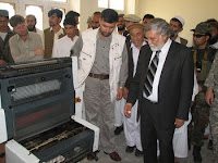 Gov. Sayeed Wahidi, the governor of Konar province, Afghanistan (dark suit), tours a new printing press facility in downtown Asad Abad. Prior to the facility opening, all print material including Asad Abad's weekly newspaper was printed in Jalalabad, Kabul or in Pakistan.