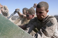 Marine Sgt. Brian Morris shovels dirt into protective barriers while building a combat outpost in the Farah province of Afghanistan earlier this month. The Marines can expect several thousand more U.S. troops to join them in Afghanistan in the coming months, according to Secretary of Defense Robert M. Gates.