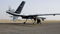 Aircrews perform a preflight check on an MQ-9 Reaper before it takes off for a mission in Afghanistan. The Reaper is larger and more heavily-armed than the MQ-1 Predator and in addition to its traditional ISR capabilities, is designed to attack time-sensitive targets with persistence and precision.