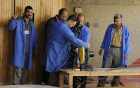 Former 'Sons of Iraq' civilian security group members learn basic mechanical skills while attending a demobilization, demilitarization and reintegration center in the Adhamiyah neighborhood of Baghdad.
