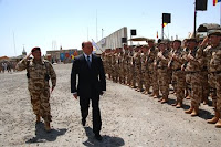 Col. Gabriel Toma, commander of the Romanian army's 26th Infantry Battalion, conducts an inspection of troops with Romanian President Traian Basescu during an end-of-mission ceremony June 4 at Contingency Operating Base Adder, Iraq.