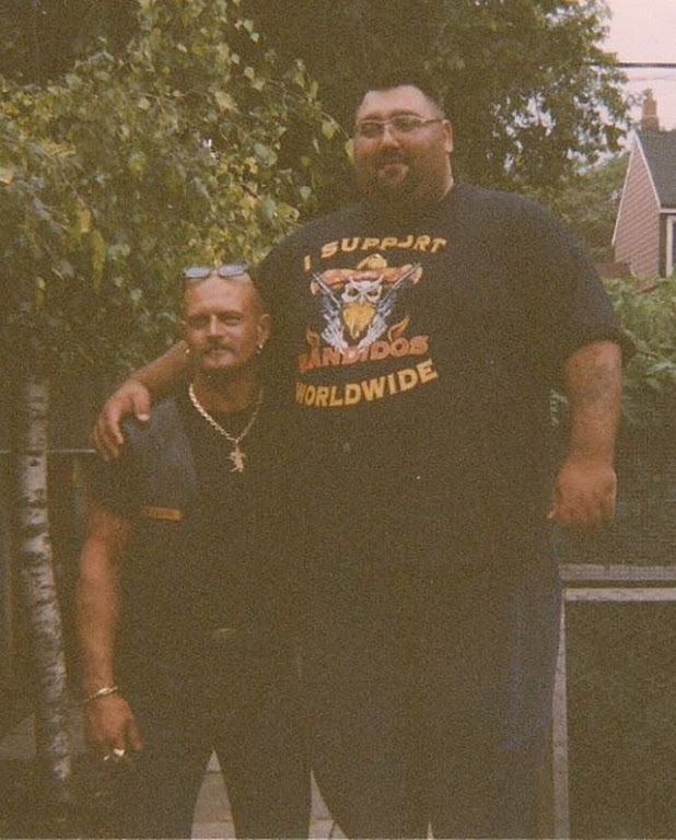 Bandidos Big Paul Sinopoli standing on milk carton and visiting biker from thailand