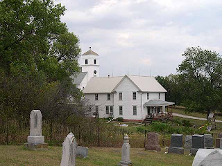 The cemetery, parsonage house and church of Immanuel Lutheran Church in Middle Creek, Nebraska. The photo is taken from http://www.sewardne.info/Cemeteries/MiddleCreek.htm