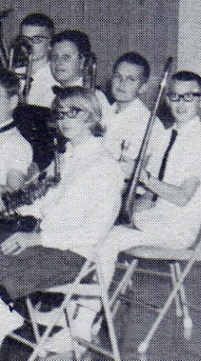 Jim Hardt and Mike Sylwester pictured as trombonists and Debbie McGrew pictured as a saxophonist in the school orchestra in the 1965-1966 yearbook of St John Elementary School in Seward, Nebraska.