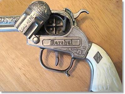 A cap-gun pistol (open). Image taken from http://www.nicholscapguns.com/halco.htm