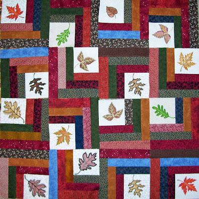 I did a trial layout of my embroidered Autumn Leaves quilt blocks just to get a better idea how this quilt will look when it is completed. Love it!