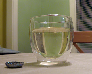 A jacketed glass of carbonated sake.