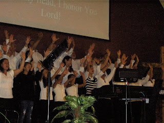 Lifting hands in praise and honor!