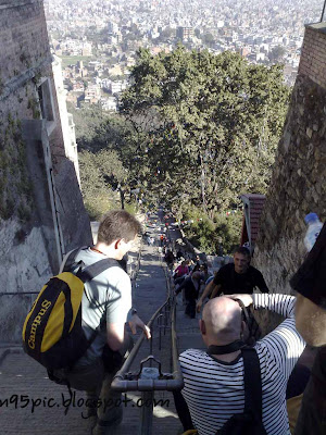 swayambhu 365 stepped stairway,Climbing swayambhunath,n95 pictures,swyambhunath in nepal,Buddha in Nepal,tourist for buddhism