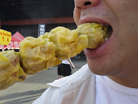This skewer of siu mai from Pang's made it a long way - to Ms mouth. (Richmond Night Market 2009)