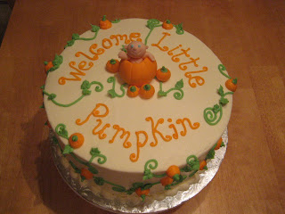 Daddy Mommy And Baby Pumpkins On A Cake