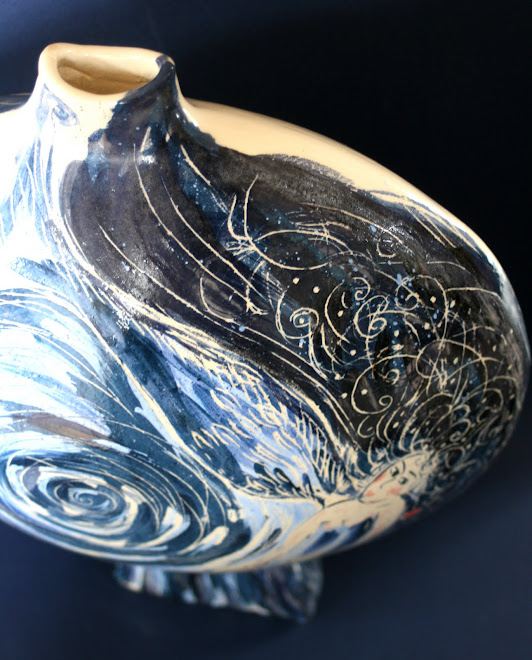 Vase poisson, avec une sirène.