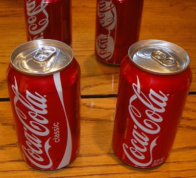 old Coca-Cola Classic can next to new Coca-Cola can without the word Classic on the can