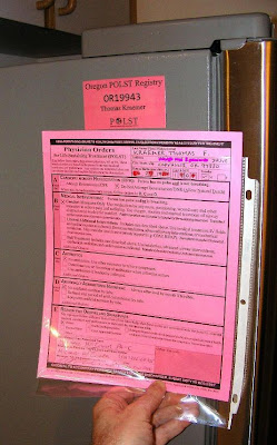 a bright pink Physician Orders for Life-Sustaining Treatment form or POLST for Thomas Kraemer Oregon POLST registry number OR19943 is shown next to a refrigerator magnet