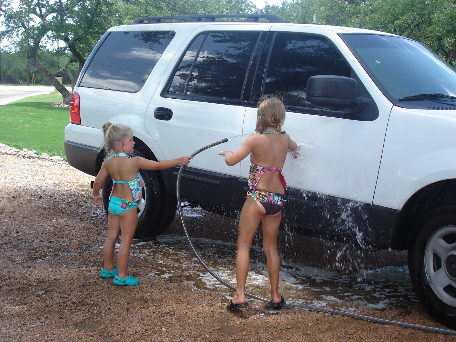 High School Bikini Car Wash http://davisdivasanddude.blogspot.com/2010/07/pink-kayaks.html