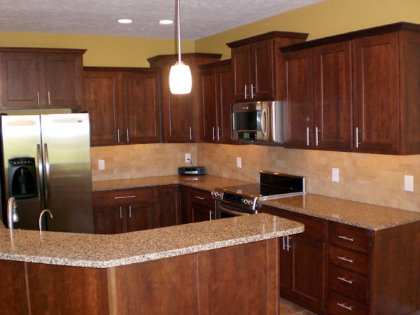 Photos of cherry cabinets and white granite counters for Brown kitchen designs