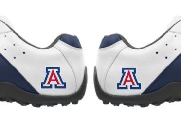 AZ Wildcats golf shoes that are white with blue trim and some red in the Arizona Wildcats logo near the sole and grip on the bottom of the athletic footwear.