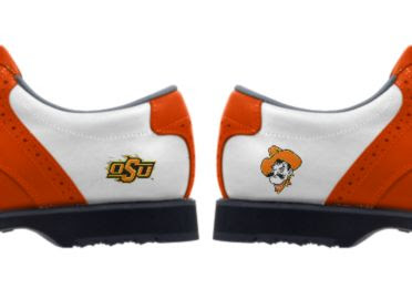 Oklahoma State University golf shoes with OSU orange and black logo and Pistol Pete cowboy mascot logo on white men's size 9 Footjoy products that are white with orange trim and black soles.