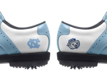 UNC golf shoes with school logos of the UNC logo and the Tar Heel Ram mascot on white and light blue footwear.