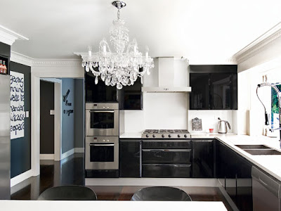 chandelier is a brilliant stroke in this<br />very modern black and white kitchen