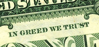 dollar bill that says in Greed We Trust