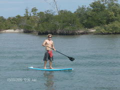A guy on a 'Stand Up Paddle Board'.  What else could it be?