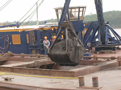 Pick the sludge out of the canal and drop it in a barge. Takes 1-1/2 hours to fill a barge.