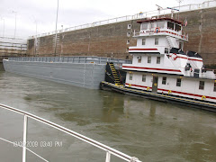 Sharing a lock with a tug and single barge. Many a tow is 3 barges across--or more