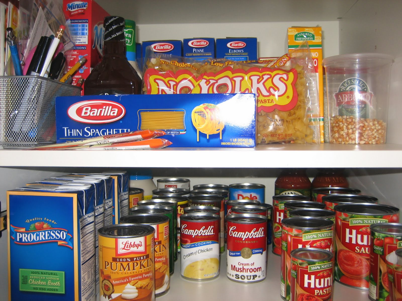 Deep, enormous pantry – mine goes at least 7 cans deep.