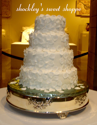 This Wedding cake was decorated entirely of White fondant Rose Petals