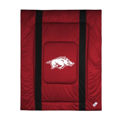Arkansas Hogs comforter or bedspread that has a Razorback logo on this red blanket.