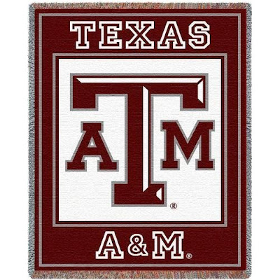 Classic Texas A&M block logo with maroon writing on white background on a blanket.