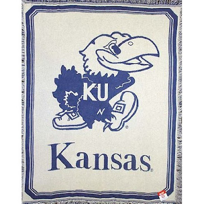 KU white Jayhawks blanket with blue trim.