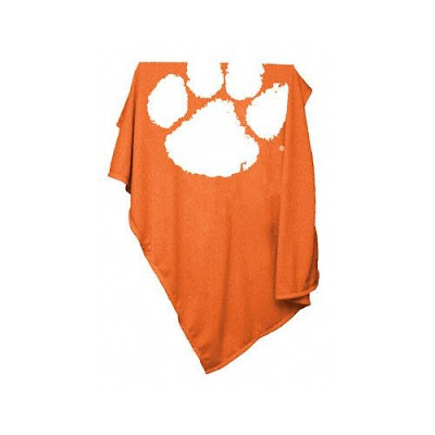 Clemson Tigers sweatshirt blanket that is orange with a white paw print.