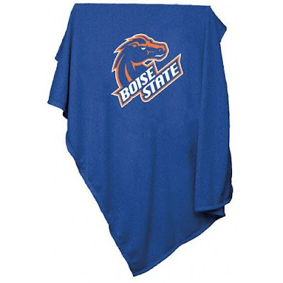 Boise State sweatshirt blanket that is blue with orange letters.