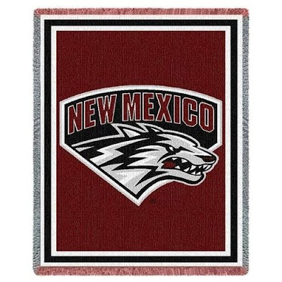 U of New Mexico blanket that is cherry colored.