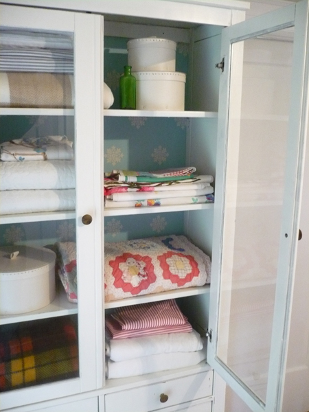 Diy linen closet from box to charm real estate house for Linen closet ikea