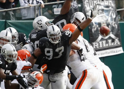 The Oakland Raiders block Phil Dawson's kick and hold on to beat the Cleveland Browns 26-24 at McAfee Coliseum in Oakland on Sunday, September 23, 2007. (Copyright San Jose Mercury News 2007.)