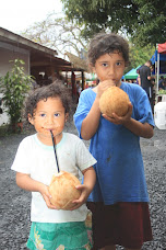 Local kids enjoying coconuts