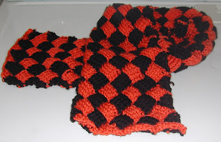 Orange and black entrelac scarf...save $10 before it's too late.