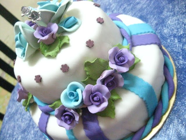 2 tier fondant cake with blue and purple theme ordered by Ms Ayna Mardiah