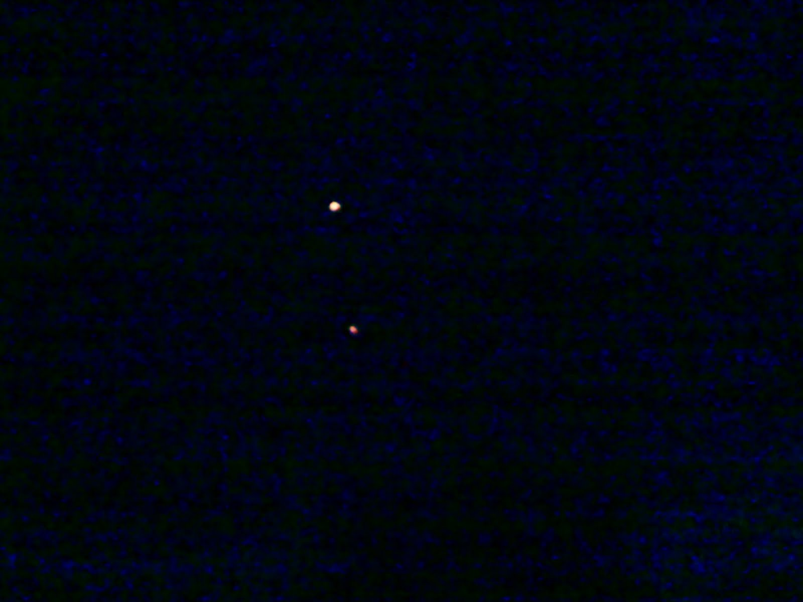 Two ufos in linked formation flying over camberley surrey uk