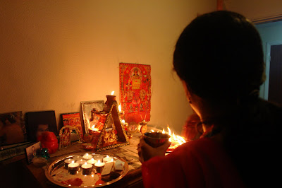 Making an offering to the God at Diwali