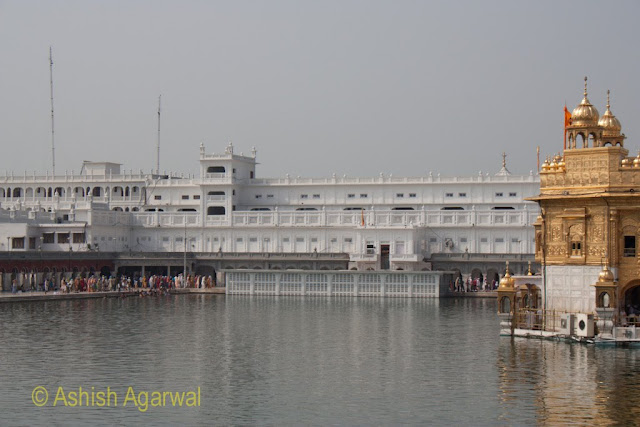 View of part of the Harmandir Sahib, sarovar and buildings around the perimeter in Amritsar
