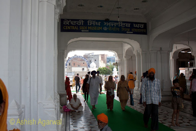 View of the small passage through which devotees pass to reach the main structure of the Harmandir Sahib in Amritsar
