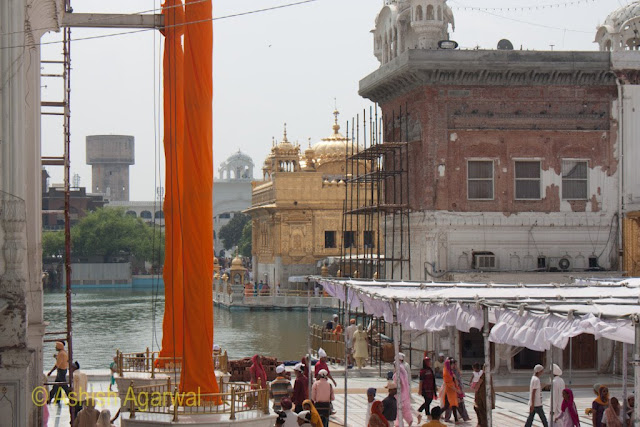 View of the dual flagstaffs (Nishaan Sahib) along with the Darshan Deori at the Golden Temple